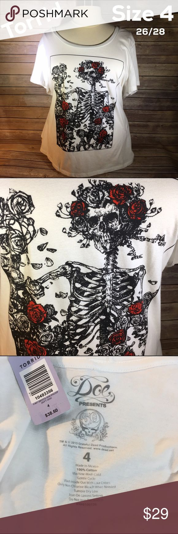 Torrid Grateful Dead Tee Shirt T-shirt 26/28 sz 4 Torrid Grateful Dead T-Shirt •Size: Torrid 4 = 26/28 •Color: White w/black & red •Brand New w/ Tag Attached •SOLD OUT at Torrid  Please review all photos to know exactlty what you are purchasing.  If I forgot anything, just tag me and ask! 💋  No 🅿️🅿️ No Ⓜ️ 🚫 Trades torrid Tops Tees - Short Sleeve