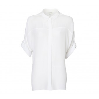 This contemporary oversized shirt was designed by the winner of the Witchery White Shirt Challenge on Project Runway Australia, Tristan Melle. It features Magyar batwing sleeve with rolled cuff, concealed button through placket and contrast fabrication panels. 100% of the gross proceeds from the sale of this shirt will go directly to the Ovarian Cancer Research Foundation to assist them in finding an early detection test for this insidious disease.