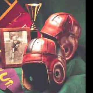 Leather football helmets found on http://PastTimeSports.biz An incredible assortment of Rare Colors and years from 1903- 1940 all for sale.