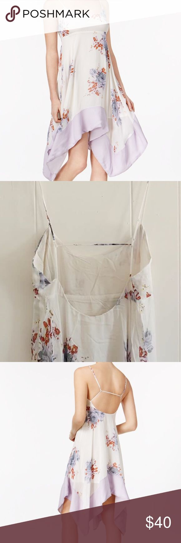 ✨FLASH SALE✨NWT Free People Dress This is A NWT Free People Faded Bloom Dress. A very beautiful dress, perfect for summer. It has an asymmetric hem and adjustable straps. Free People Dresses Asymmetrical