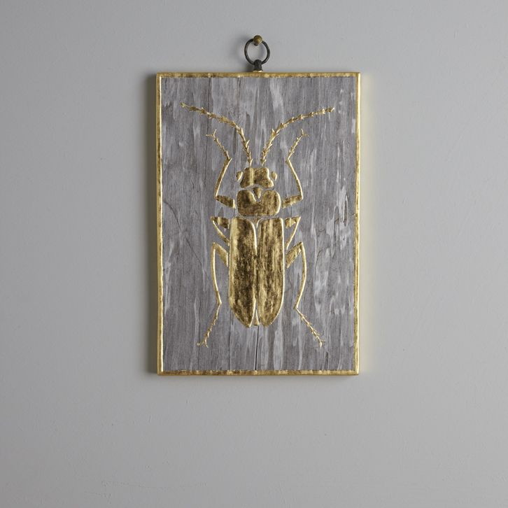 Beetle V. 18.5 x 12.5 cm. A 23.5 carat gold leaf beetle on a grey wood veneer.