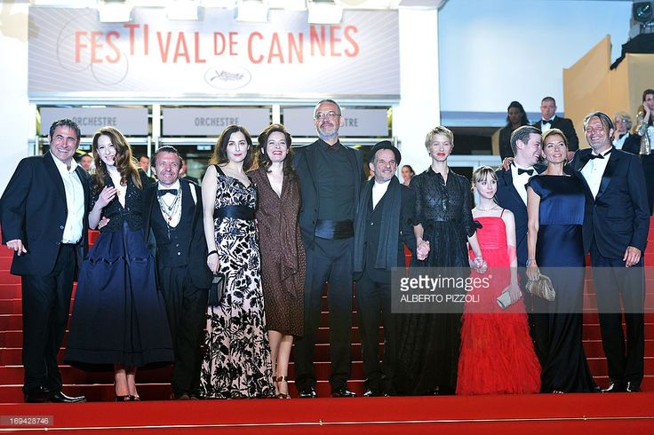 Spanish actor Sergi Lopez, French-Austrian actress Roxane Duran, Swiss actor David Bennent, French actress Amira Casar, director Arnaud des Pallieres and his partner, French actor Denis Lavant, French actresses Delphine Chuillot and Melusine Mayance, German actor David Kross and Danish actor Mads Mikkelsen and his wife Hanne Jakobsen pose on May 24, 2013 as they arrive for the screening of the film 'Michael Kohlhaas' presented in Competition at the 66th edition of the Cannes Film Festival…