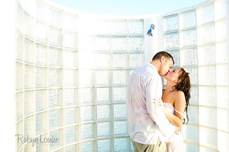 Trash the Dress in the pool shower at the Grand Sunset Princess, Playa Del Carmen, Mexico | Robyn Louise Photography Quesnel, Williams Lake and Cariboo BC Engagement Photography Photographer. Available worldwide. Engagements | Robyn Louise Photography www.robynlouise.com Engagements | Robyn Louise Photography  Trash the Dress | Robyn Louise Photography