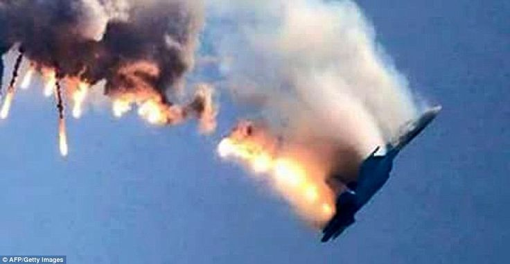 This image shows the moment the Russian Sukhoi Su-24 jet was shot down by Turkish F-16 fig...