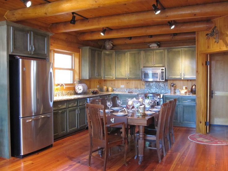 Log cabin kitchen green for Cabin kitchen cabinets