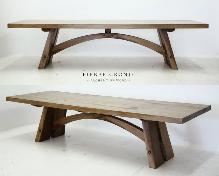 A Pierre Cronje Bloukrans dining table in French Oak. The design of the table is based on the Bloukrans bridge in Nature's Valley.