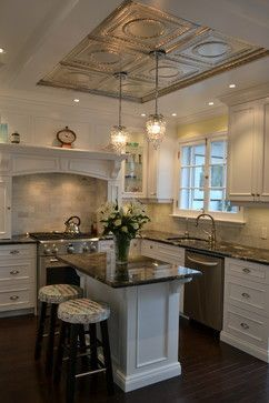 Victorian Style White Kitchen Decorating Ideas with Marble Subway Tile, Framed Tin Ceiling Accent and Elegant Hanging Pendants. I adore this kitchen!