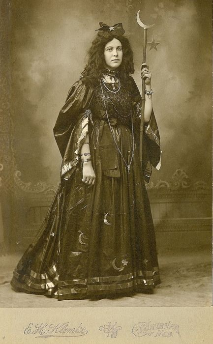 circa 1885. You'd think someone in an outfit this fabulous would be smiling...