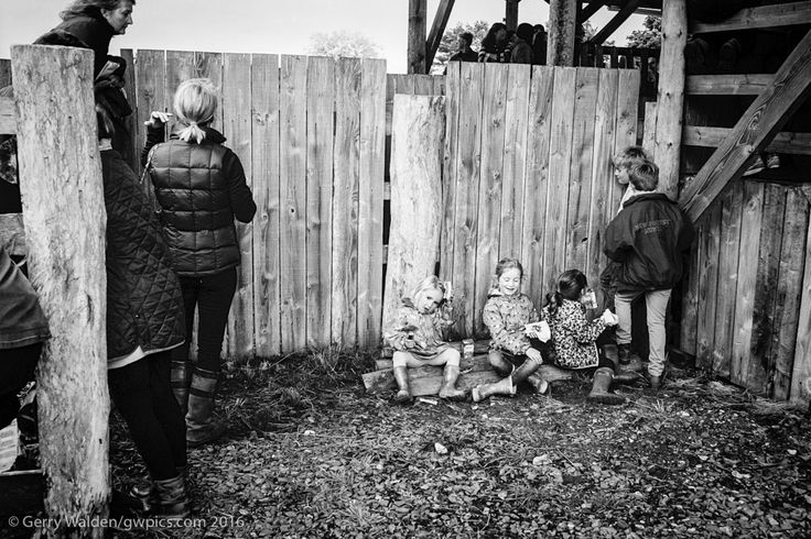 https://flic.kr/p/HPQdUM | Children at the Pony Sales | Children eat their lunch against a fence whilst their mothers chat to friends at the pony sales in the New Forest National Park, Hampshire, England.
