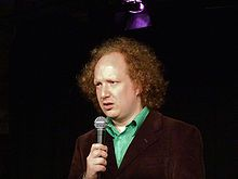 """#Andy_Zaltzman .jpg """"Andrew """"Andy"""" Zaltzman (born 6 October 1974) is a British comedian and author who largely deals in political material. He has worked extensively with John Oliver; their work together includes Political Animal, The Department, and The Bugle. His performance style is centred on verbal dexterity, and for his love (and extensive use) of puns, especially in extended pun runs (for example, within The Bugle podcast[1])"""""""