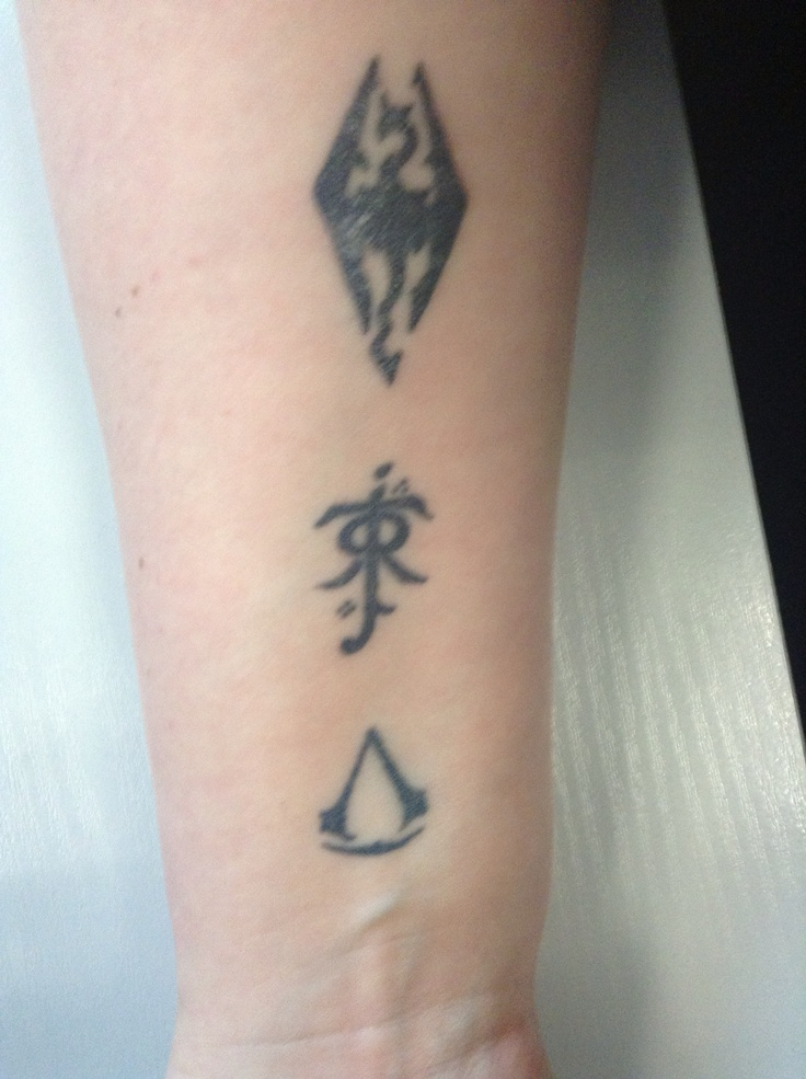 Awesome geek tattoos. #skyrim #assassins creed #tolkien