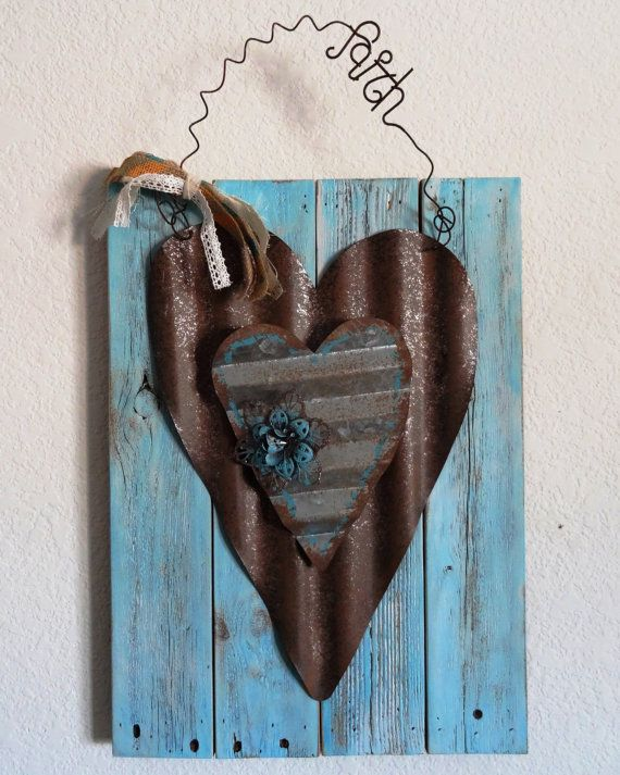 This sign was handcrafted with Reclaimed Wood, Rusty Corrugated Tin Hearts, Wire Faith hanger and a Burlap Bow. The wood was hand painted and