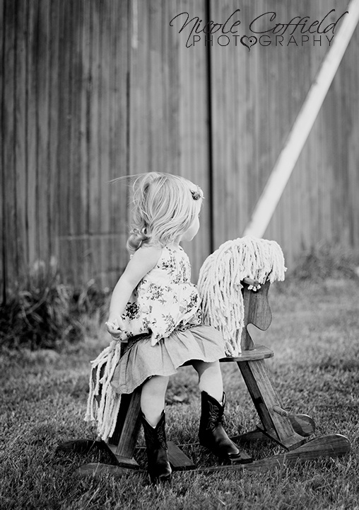 little country girl on a rocking horse - toddler photography at a barn