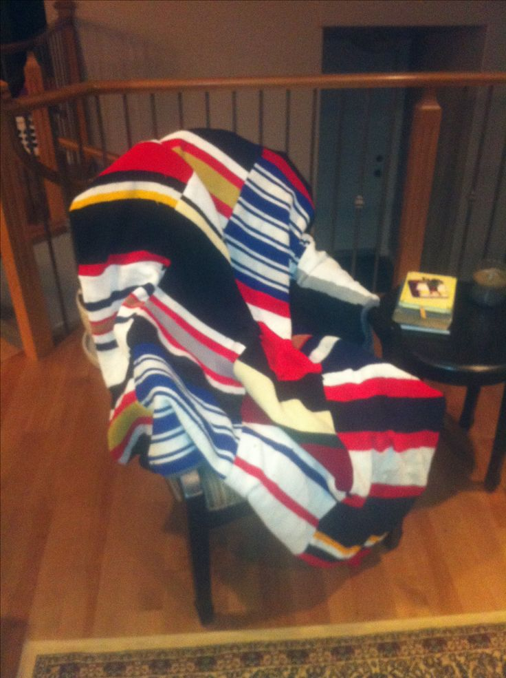 Finally found a use for my boys old hockey socks!! The perfect rink blanket!!