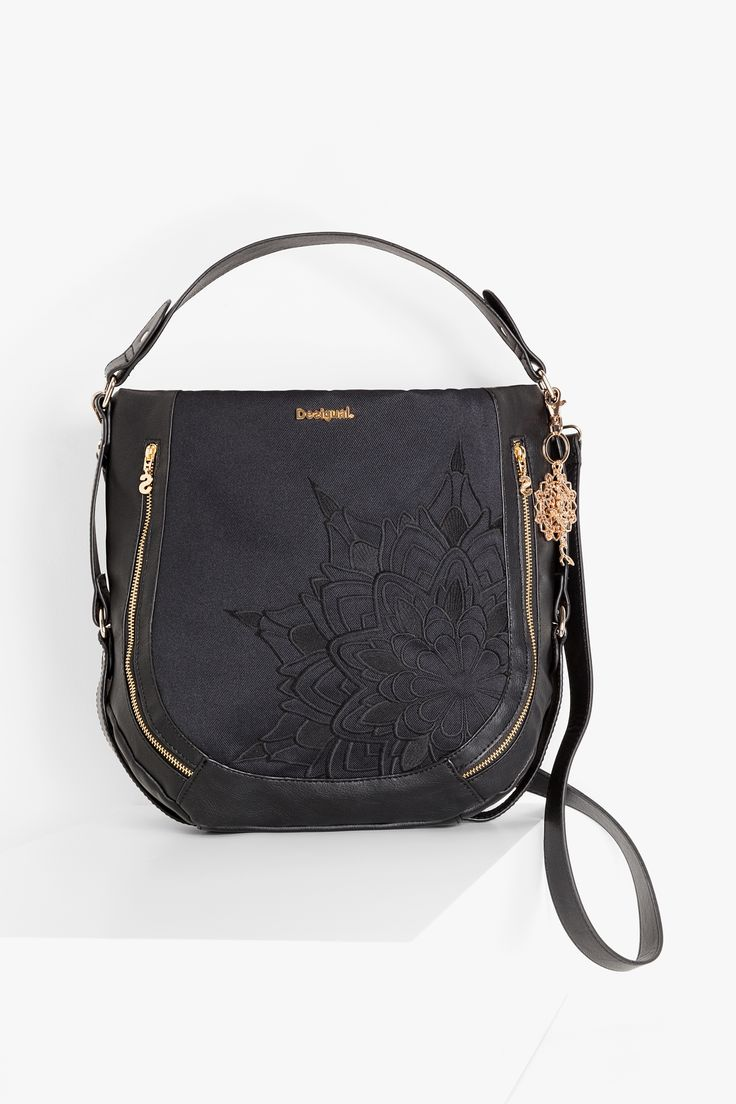 This black bag is another Desigual interpretation of a classic piece. This black bag is versatile but also has an exotic print and gold filigree style keychain.