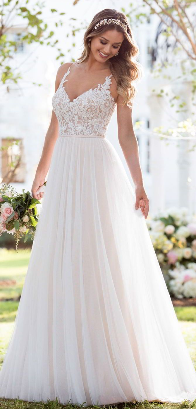 Soft, romantic, and light-as-air, this boho wedding dress from Stella York was made for the laidback, casually-cool bride. The bodice of this French tulle over matte-side Lavish satin gown is constructed of double organza, giving the appearance of sheerness. Adorned with lace swirls and beading, it is the perfect complement to the tulle, A-line skirt. The back of this gown features an intricately-detailed illusion-tulle design, and a slight train, making it perfect for a boho-inspired…