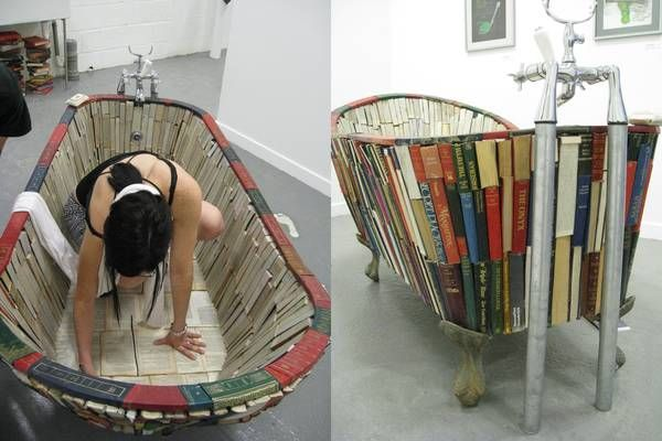 """Functional bathtub made from books. """"Bathe in knowledge""""."""
