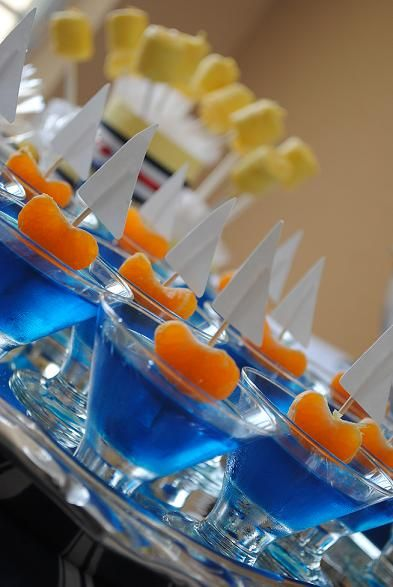 Jello sailboats. Using blue jello,mandarin slices,toothpicks, and white paper. Such a simple idea but oh so cute for a party.