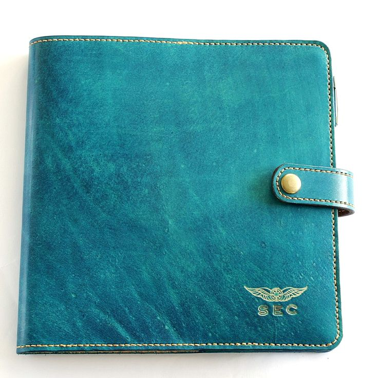 Womens pilot logbook cover with intials and wings in azure blue with butterscotch stitching.  100% genuine leather, hand dyed, hand stitched. Hand made to measure international pilot logs. Options include snap closure, penholder and credit card sized licence pocket. Raspberry pink also available. FREE overseas shipping on some orders.