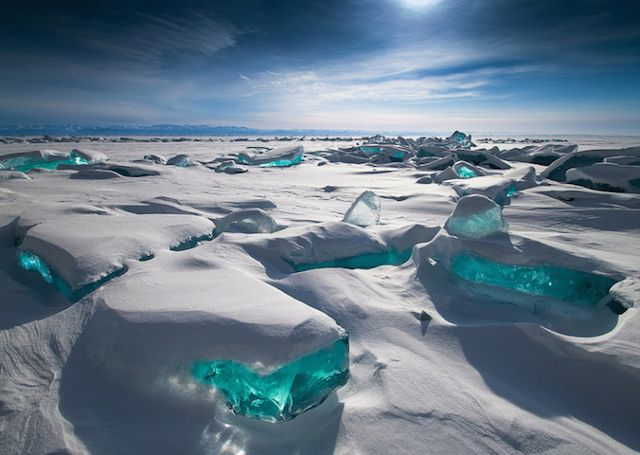 Turquoise Ice Gems Emerging From Russian Lake