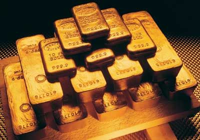 PRECIOUS-Gold turns higher as dollar down ahead of Fed minutes