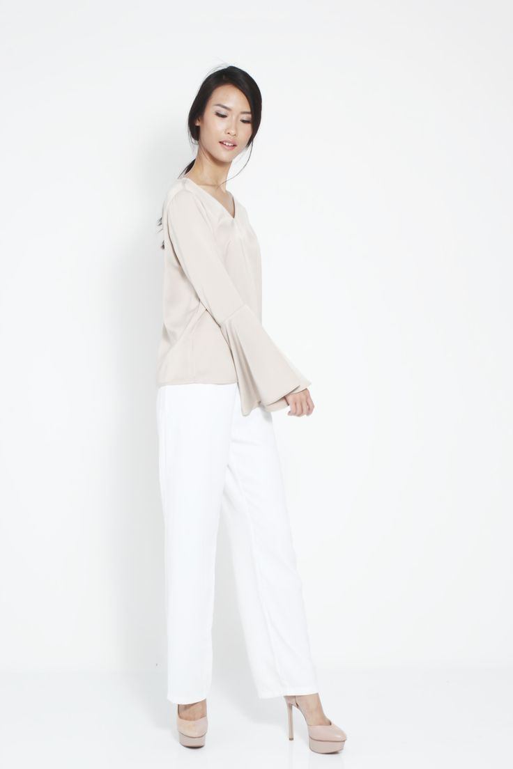 Don't miss a chance to have this easy and versatile top by kim.