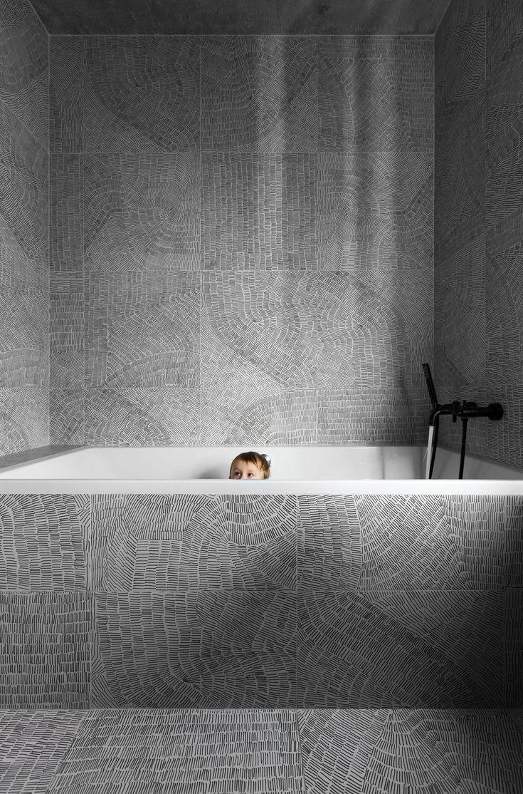 Designed for a family, architect Sergey Makhno created the Wabi Sabi Apartment by merging elements of Ukrainian design with Japanese minimalism.