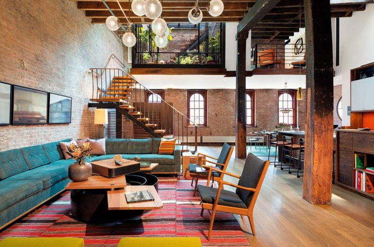 http://www.drissimm.com/wp-content/uploads/2015/10/elegance-living-room-in-loft-also-striped-rug-under-table-also-turquoise-sofa-plus-brick-wall-and-kitchen-in-the-near-stairs.jpg