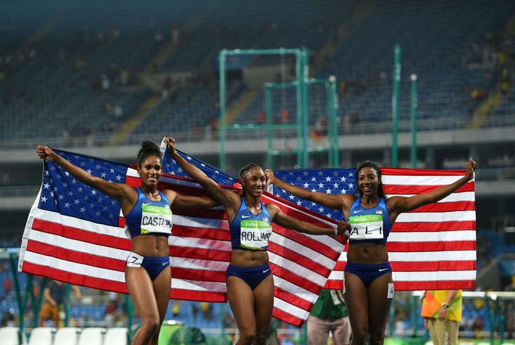 Brianna Rollins (USA) , Nia Ali (USA) and Kristi Castlin (USA) celebrate with American flags after claiming medals in the women's 100-meter hurdles.