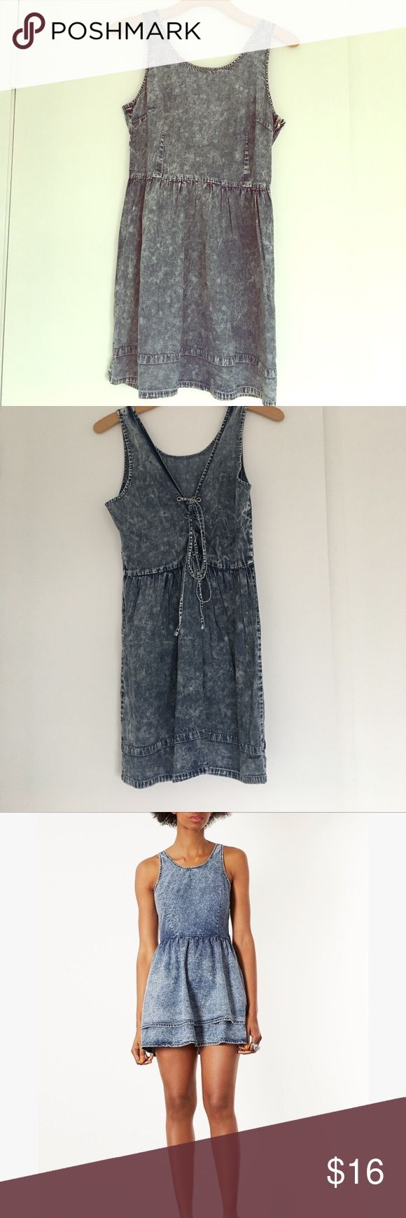 Denim Skater Dress 100% cotton denim dress that looks exactly (is?) the Moto Denim Acid LaceUp Skater Dress from TOPSHOP. (Pics 3 & 4 for comparison). Brand name and size tags are missing but I'm pretty sure it's a size XS to Small. Dresses Mini