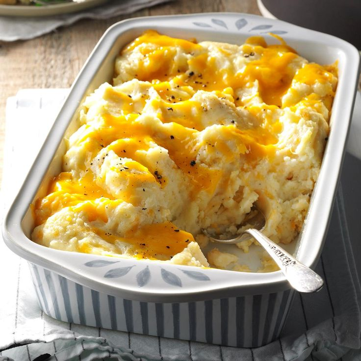 Cheesy Mashed Potatoes Recipe -Everyone who has tasted these creamy, cheesy potatoes asks how to make them. Since this comforting casserole bakes at the same temperature as my chicken bundles, I get it started in the oven and pop in the entree a little later. -Brad Moritz, Limerick, Pennsylvania