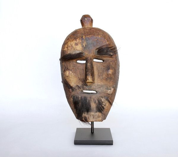 A wooden mask of great character from Nepal, high cheekbones, well defined nose…