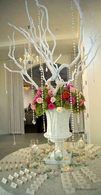 Place card table statement piece! Tall manzanita branches,green pegee hydrangea,roses,crystals, and candlelight. Big,bold,colorful!