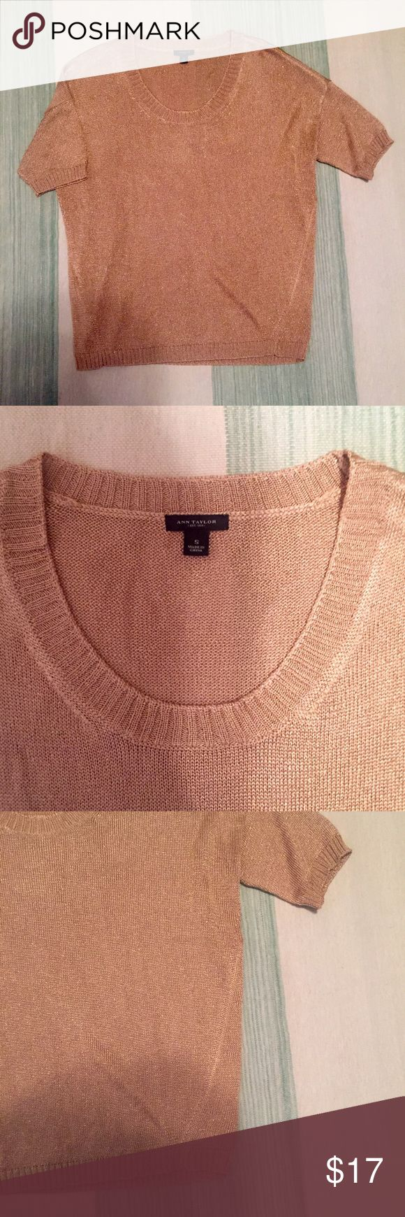 Ann Taylor gold metallic short sleeve top Size S Ann Taylor gold knit short sleeve top size small. Loose fit. Crewneck. Gold metallic. Stretchy material. No snags or signs of wear. Ann Taylor Tops Tees - Short Sleeve