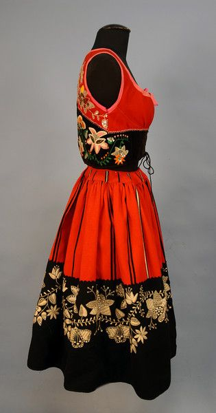 Womans Portugese vest and skirt with elaborate decoration on red and black wool felt.