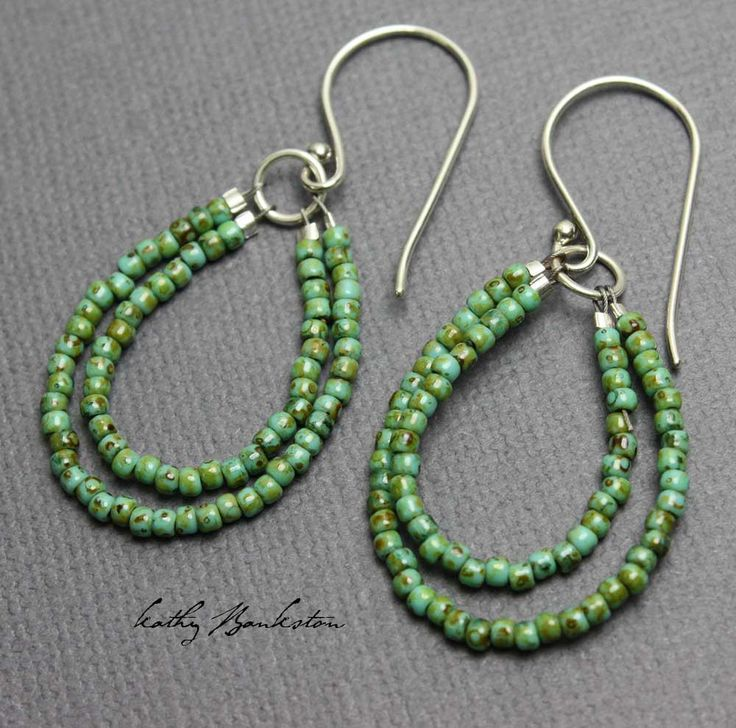 Shiny antiqued turquoise green glass seed bead earrings. This is a very pretty…