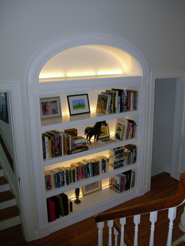 A Large Deep Paint Grade Open Bookcase With Elliptical Casing And Led Back Lighting
