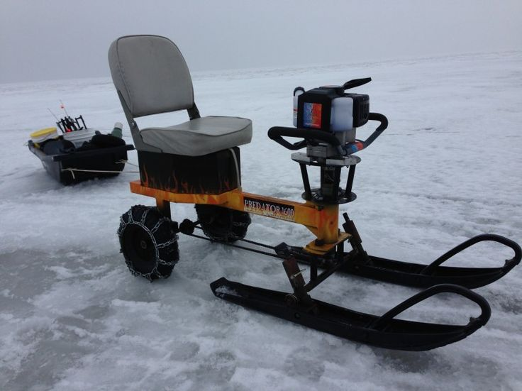 The ice auger machine set up with snowmobile skis for Ice fishing snowmobile