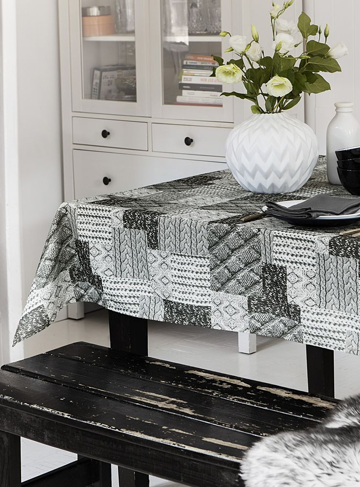 Exclusively from Simons Maison     Small knit squares printed in a patchwork look in this season's Scandinavian comfort style. The perfect tablecloth for enjoying the holiday season's comfort dishes.    High-quality polyester   Easy-care, machine wash and dry   Never needs ironing   Looks beautiful after repeated washing   Matching napkin and table runner also available