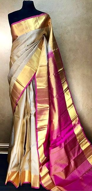 Off white kanchivaram saree with a gold border and pink pallu