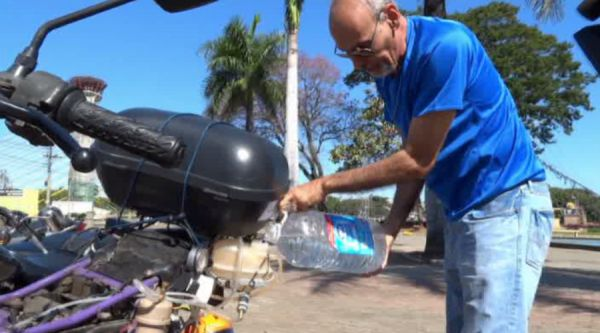 "A Brazilian man, Ricardo Azevedo from Sao Paulo, has shown off his wonder bike to the world. The magic machine can travel up to 500 kilometers on a liter of water. The so-called ""T Power H20"" vehicle is powered by water and an external car battery to produce electricity and split the hydrogen from the water molecules. As a result, combustion is created giving the motorbike the impetus to move. In the video, Azevedo first drinks from the bottle, proving that it's indeed water and..."