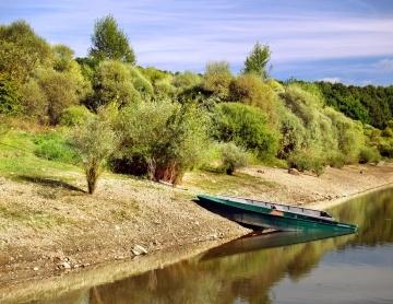 Two boats reflected in the Liptovska Mara lake, in Slovakia.
