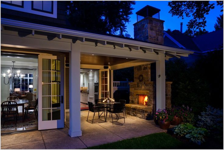 Patio Craftsman columns covered patio Craftsman Exterior Fireplace french doors outdoor dining furniture outdoor fireplace Patio patio furniture potted plants stone stone chimney traditional design white trim id-1060