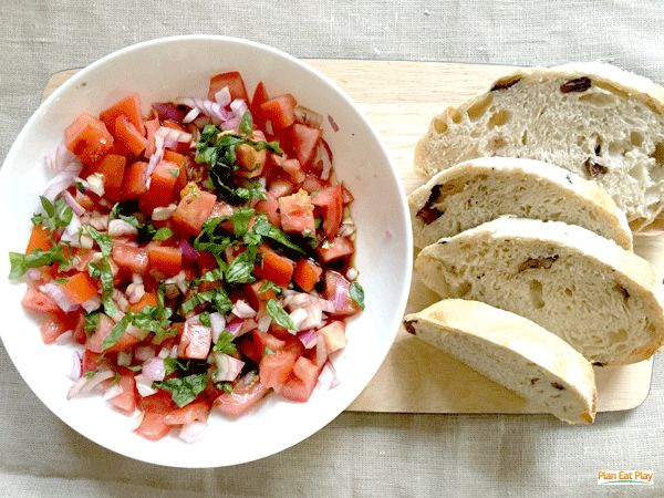 Tomato and Basil bruschetta with olive bread for more great tomato recipes, check out our 12 ways to wrap up the year special www.planeatplay.com #planeatplay