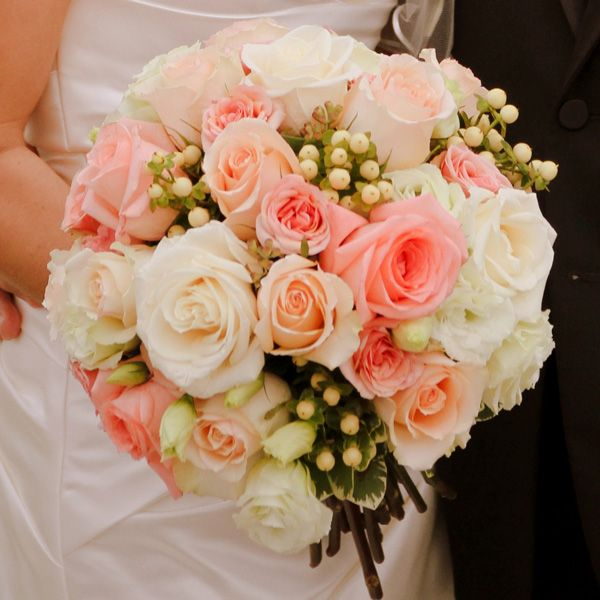 The perfect bridal bouquet. Perfectly round and balanced... just needs to have more soft rose and pinks, versus a coral colored flower. But I love this arrangement.