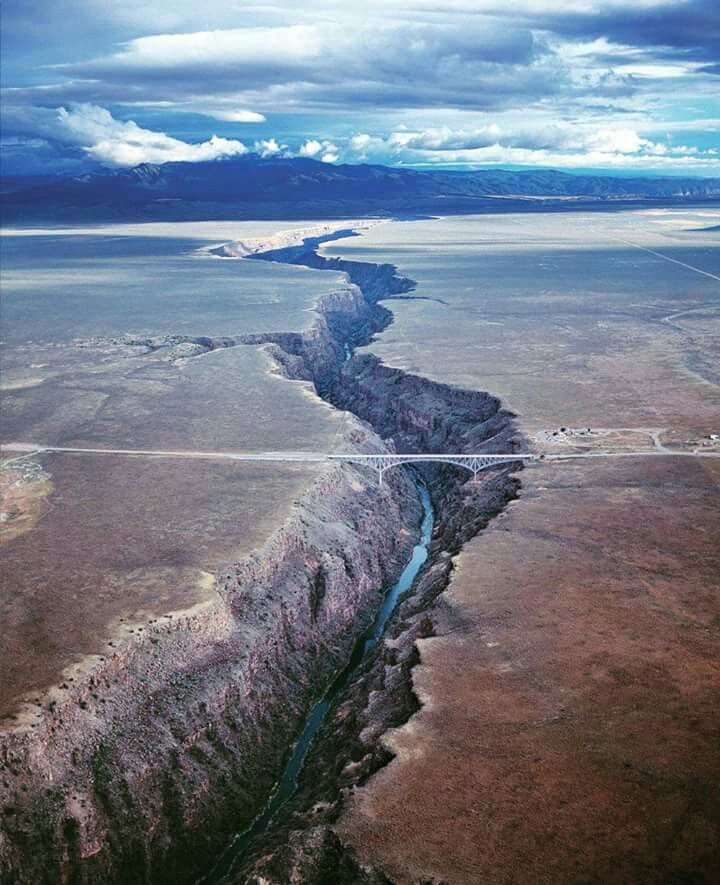"""The Rio Grande Gorge Bridge, locally known as the """"Gorge Bridge"""" and the """"High Bridge,""""[2] is a cantilever truss bridge across the Rio Grande Gorge 10 miles (16 km) northwest of Taos, New Mexico, United States. At 650 feet (200 m) above the Rio Grande, it is the fifth highest bridge in the United States"""