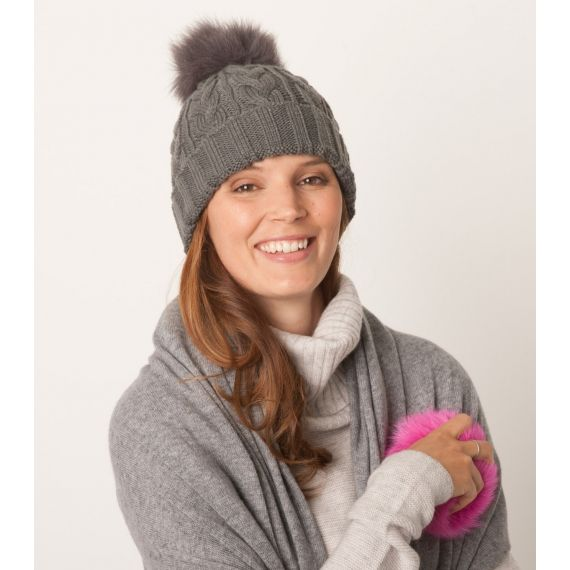 Milly Interchangeable Pom Pom Hat Grey. £57. Interchangeable pom poms means you get two hats for the price of one! Boasting the classic beanie style, the Milly Pom Pom hat features a chunky cable knit with folded ribbed edge. Worldwide Shipping Available.