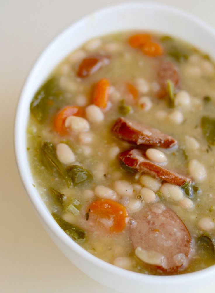 This smoked sausage, white bean, and vegetable soup is a tried and true family favorite. It used to take me hours to make, but in the Instant Pot,it's done in less than one hour. :) One of the staple soups in ourhouse is adapted from a recipe I found years ago on Budget Bytes. Imake itwith smoked turkey sausage, white beans, carrots, celery, spinach, garlic, onion, and fresh herbs. With the smokiness of the sausage and the addition of fresh thyme and rosemary, it's got great flavo...