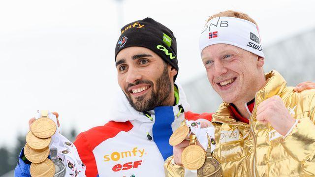 Martin Fourcade avec le Norvégien Johannes Thingnes Boe, vainqueur de la mass start des Mondiaux de biathlon d'Oslo, le 13 mars 2016