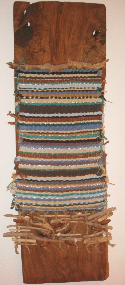 Crusoe: Abstract sea and island scape. Hand woven fibre art mounted on a piece of ancient oak.